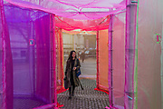 The Inevitable by multi media Artist Sally Buchanan as part of this year's The Flux Exhibition, on the Rootstein Hopkins Parade Ground of Chelsea College of The Arts. An outdoor interactive installation, consisting of over 220 metres of Organza and 25 yards of Crinoline fabric allowing visitors to walk through a simple series of 10 interlinked hexagonal compartments. It will be there from 11th – 15th April 2018.