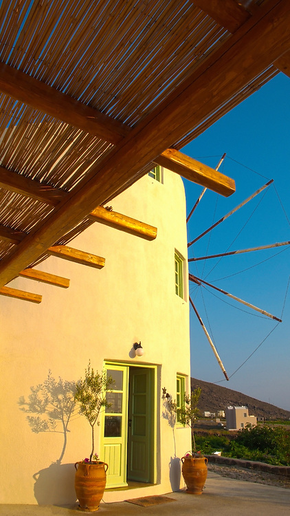 Santorini windmill villa at sunrise.