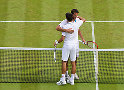 02.07.2014, All England Lawn Tennis Club, London, ENG, ATP Tour, Wimbledon, im Bild Novak Djokovic (SRB) embraces Marin Cilic (CRO) after winning the Gentlemen's Singles Quarter-Final match on day nine // during the Wimbledon Championships at the All England Lawn Tennis Club in London, Great Britain on 2014/07/02. EXPA Pictures © 2014, PhotoCredit: EXPA/ Propagandaphoto/ David Rawcliffe<br /> <br /> *****ATTENTION - OUT of ENG, GBR*****