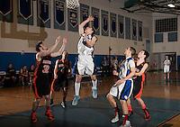 Winnisquam versus Farmington NHIAA Division III basketball tournament action.  Karen Bobotas/for the Concord Monitor