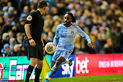 Fankaty Dabo of Coventry City (23) tries to keep the ball in play during the EFL Sky Bet League 1 match between Coventry City and Rotherham United at the Trillion Trophy Stadium, Birmingham, England on 25 February 2020.