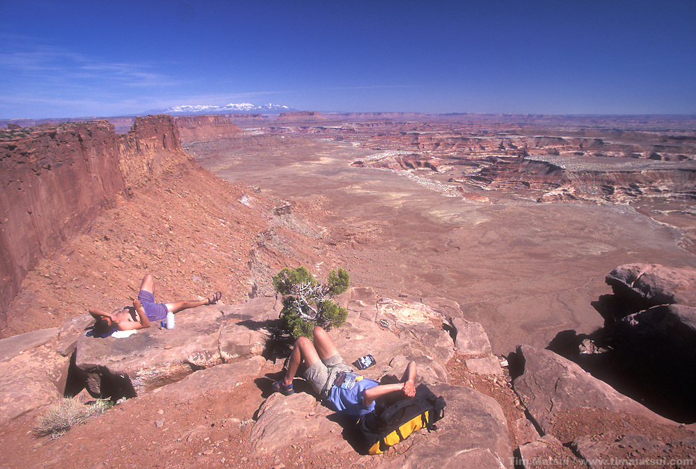 Dan Aylward and Forrest Murphy relax near the Maze District of Canyonlands National Park, Utah.