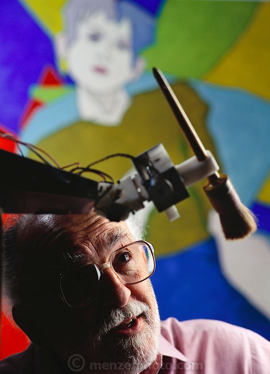 "Harold Cohen, former director of the Center for Research in Computing and the Arts (CRCA), is the author of the celebrated AARON program, an ongoing research effort in autonomous machine (art making) intelligence. Cohen is seen looking at his creation, a robot ""artist"" that painted the picture in the background. California, USA"