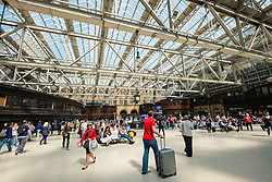 busy public concourse at Glasgow Central Station in Glasgow United Kingdom