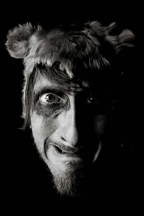 funny looking man with a bear´s hat grinning into the camera