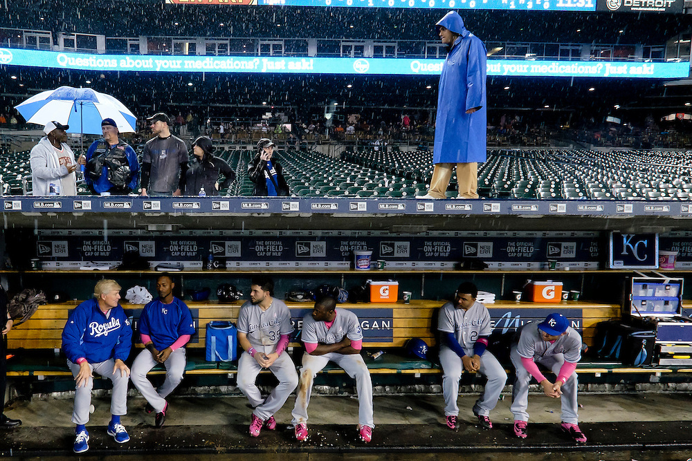 May 10, 2015; Detroit, MI, USA; Kansas City Royals first base coach Rusty Kuntz (left to right) Jarrod Dyson (1) first baseman Eric Hosmer (35) enter fielder Lorenzo Cain (6) and third baseman Christian Colon (24) sits in dugout during a rain delay in the ninth inning against the Detroit Tigers at Comerica Park. Mandatory Credit: Rick Osentoski-USA TODAY Sports