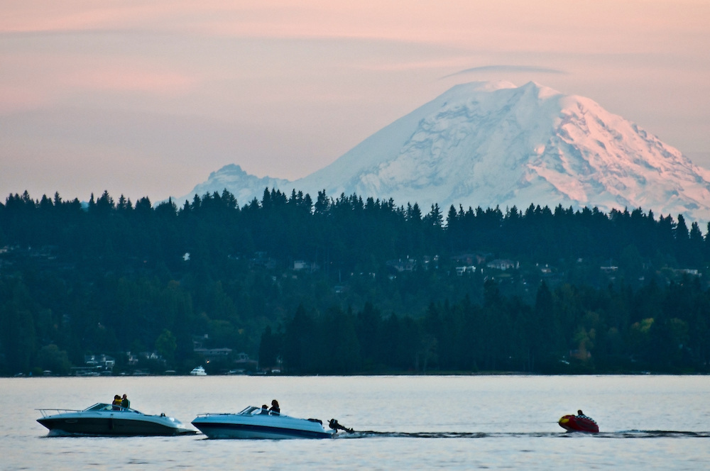 Boating on Lake Washington, with Mount Rainier in the background, at Magnuson Park, Seattle, Washington.