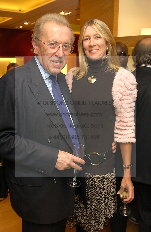 SIR DAVID & LADY CARINA FROST at a party hosted by Burberry to launch their special collection in aid of Breakthrough Breast Cancer, held at 21-23 New Bond Street, London W1 on 5th October 2004.<br /><br />NON EXCLUSIVE - WORLD RIGHTS
