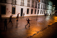 Protestors throw rocks at the windows of the state legislature building, in Rio de Janeiro, Brazil, Monday, June 17, 2013. Protests in Sao Paulo, Rio de Janeiro and other major Brazilian cities began with a 20-cent hike in public transport fares, have clearly moved beyond that issue to widespread frustration in Brazil about a heavy tax burden, politicians widely viewed as corrupt and woeful public education, health and transport systems and come as the nation hosts the Confederations Cup soccer tournament and prepares for next month's papal visit. <br />
