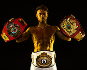 Stylized portrait of Boxing Champion Austin Williams with title belts from first year of amateur boxing.