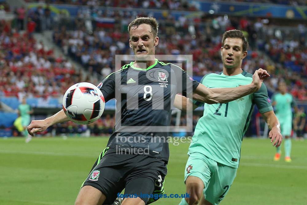 Andy King of Wales and Cedric of Portugal in action during the UEFA Euro 2016 semi-final match at Stade de Lyons, Lyons<br /> Picture by Paul Chesterton/Focus Images Ltd +44 7904 640267<br /> 06/07/2016