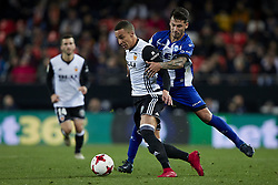 January 17, 2018 - Valencia, Valencia, Spain - Rodrigo Moreno (C) of Valencia CF competes for the ball with Hernan Perez (R) of Deportivo Alaves during the Copa del Rey quarter-final first leg  game between Valencia CF and Deportivo Alaves at Mestalla stadium on January 17, 2018 in Valencia, Spain  (Credit Image: © David Aliaga/NurPhoto via ZUMA Press)