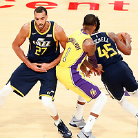10 October 2017: Utah Jazz guard Donovan Mitchell (45) drives past Los Angeles Lakers guard Kentavious Caldwell-Pope (1) on a screen set by Utah Jazz center Rudy Gobert (27) during the Utah Jazz 105-99 victory over the LA Lakers, at the Staples Center, Los Angeles, California, USA.