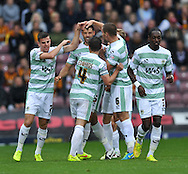 Aaron Martin of Yeovil Town (C) celebrates making it 1-0 during the Sky Bet League 1 match at the Coral Windows Stadium, Bradford<br /> Picture by Richard Land/Focus Images Ltd +44 7713 507003<br /> 06/09/2014