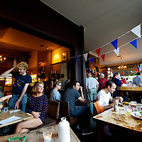 East London denizens enjoy lunch in a gastro pub while watching Michael Phelps win his 17th gold medal in the 100 butterfly during the 2012 London Summer Olympics.