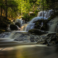 This morning I escaped the shimmering lights of Boston and traveled to Southern New Hampshire for some waterfall photography. Garwin Falls is the most beautiful waterfall in New Hampshire and probably one of the most scenic waterfalls in all New England. After a rainy spring waterflow was still good and I arrived early enough to make good use of the morning light. Equipped with a variety of Lee filters I create a silky water effects through a long exposure of multiple seconds and was able to control the light between darker foregrounds and brighter parts of the scenery I got to work.    <br />