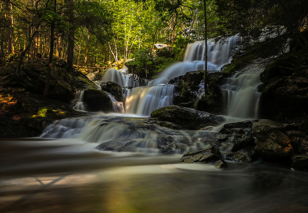This morning I escaped the shimmering lights of Boston and traveled to Southern New Hampshire for some waterfall photography. Garwin Falls is the most beautiful waterfall in New Hampshire and probably one of the most scenic waterfalls in all New England. After a rainy spring waterflow was still good and I arrived early enough to make good use of the morning light. Equipped with a variety of Lee filters I create a silky water effects through a long exposure of multiple seconds and was able to control the light between darker foregrounds and brighter parts of the scenery I got to work.    <br /> <br /> Southern New Hampshire Garwin Falls photography pictures are available as museum quality photography prints, canvas prints, acrylic prints or metal prints. Prints may be framed and matted to the individual liking and decorating needs at:<br /> <br /> https://juergen-roth.pixels.com/featured/southern-new-hampshire-garwin-falls-juergen-roth.html<br /> <br /> All high resolution New Hampshire photography images are available for photo image licensing at www.RothGalleries.com. Please contact me direct with any questions or request. <br /> <br /> Good light and happy photo making!<br /> <br /> My best,<br /> <br /> Juergen<br /> Prints: http://www.rothgalleries.com<br /> Photo Blog: http://whereintheworldisjuergen.blogspot.com<br /> Instagram: https://www.instagram.com/rothgalleries<br /> Twitter: https://twitter.com/naturefineart<br /> Facebook: https://www.facebook.com/naturefineart