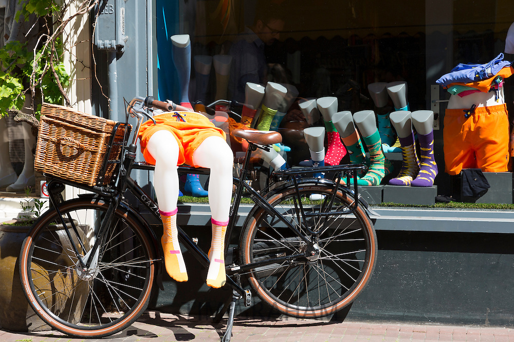 Bicycle and mannequin outside men's shop in the Nine Streets, de 9 Straatjes,  shopping district, Amsterdam