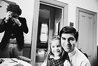 1976, Brookline, Massachusetts, USA --- Michael Dukakis Sitting with His Daughter --- Image by © Owen Franken