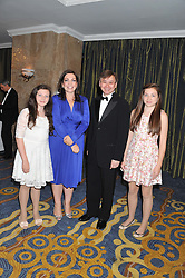 Left to right, JULIET HUGHES, ROISIN DONNELLY The corporate marketing director and head of marketing for P&G UK, IRWIN LEE Procter & Gamble, Managing Director UK and CORDELIA HUGHES at the 20th CEW (UK) Achiever Awards 2012 - celebrating two decades of women, passion, beauty, held at the Hilton, park Lane, London on 16th October 2012.