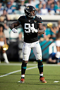 Jacksonville Jaguars defensive end Yannick Ngakoue (91) waves his arms during the NFL week 13 regular season football game against the Indianapolis Colts on Sunday, Dec. 2, 2018 in Jacksonville, Fla. The Jaguars won the game in a 6-0 shutout. (©Paul Anthony Spinelli)