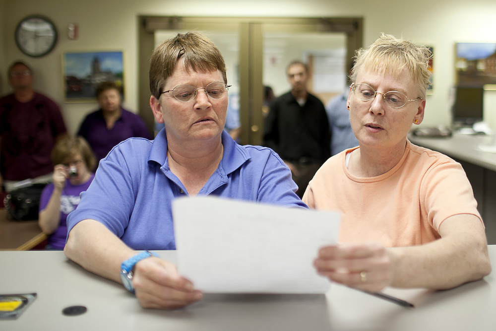 Nancy Ryherd (left) and Linda Schroeder go over their paperwork while applying for their civil union license in the county clerk's office at the Macon County Office Building just after 12 midnight Wednesday, June 1, 2011, in Decatur, Ill. (Stephen Haas)