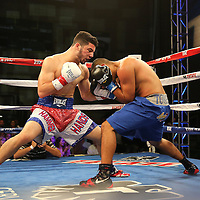 TAMPA, FL - FEBRUARY 28:  Julian Rodriguez (L) fights against Raul Tovar during the SoloBoxeo Tecate boxing match at the University of South Florida Sundome on February 28, 2015 in Tampa, Florida. Rodriguez won the bout by knocking down Tovar three times in the first round.  (Photo by Alex Menendez/Getty Images) *** Local Caption *** Julian Rodriguez; Raul Tovar