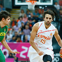 06 August 2012: Spain Victor Sada drives past Brazil Raul Neto during 88-82 Team Brazil victory over Team Spain, during the men's basketball preliminary, at the Basketball Arena, in London, Great Britain.