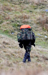 © licensed to London News Pictures. WALES, UK  25/04/11. The SAS is facing a recruitment crisis because soldiers do not have time to train for demanding selection tests, the head of the infantry has warned. Brigadier Richard Dennis said it needed better quality applicants. FILE PHOTOGRAPH DATED 14/01/11. SAS recruits taking part in 'selection' over the Brecon Beacons and Elan Valley in Wales. With a reported pass rate of less than 10% it is considered one of the toughest military selection processes in the world. . Please see special instructions for usage rates. Photo credit should read Andrew Chittock/LNP