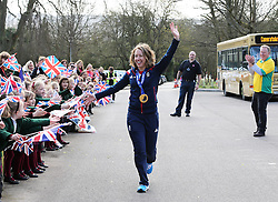 Winter Olympic Gold medalist Lizzy Yarnold is greeted by flag waving pupils as she returns to her former school, St.Michael's Preparatory School in Otford, Kent ,United Kingdom, during an open top bus parade through the county,  Friday, 21st March 2014. Picture by Stephen Lock / i-Images