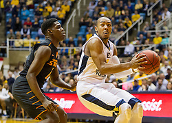 Jan 9, 2016; Morgantown, WV, USA; West Virginia Mountaineers guard Jevon Carter (2) drives the lane during the first half against the Oklahoma State Cowboys at the WVU Coliseum. Mandatory Credit: Ben Queen-USA TODAY Sports