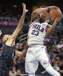 November 14, 2018 - Orlando, FL, USA - The Philadelphia 76ers' Jimmy Butler (23) pulls down a rebound over the Orlando Magic's Evan Fournier at the Amway Center in Orlando, Fla., on November 14, 2018. (Credit Image: © Stephen M. Dowell/Orlando Sentinel/TNS via ZUMA Wire)