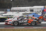 20th May 2018, Winton Motor Raceway, Victoria, Australia; Winton Supercars Supersprint Motor Racing; James Courtney and Garth Tander battle during race 14 of the 2018 Supercars Championship