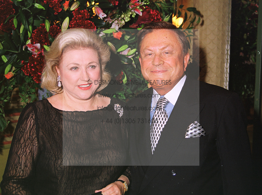 Top selling writer BARBARA TAYLOR BRADFORD and her husband MR ROBERT BRADFORD at a party in London on 8th July 1999.MUD 11