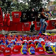VENEZUELAN POLITICS / POLITICA EN VENEZUELA<br /> Seller of shirts and caps of political slogans / Vendedor de camisas y gorras de consignas politicas<br /> Caracas - Venezuela 2007<br /> (Copyright © Aaron Sosa)