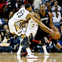 Oct 23, 2013; New Orleans, LA, USA; New Orleans Pelicans power forward Anthony Davis (23) defends against Miami Heat power forward Chris Bosh (1) during the first half of a preseason game at New Orleans Arena. Mandatory Credit: Derick E. Hingle-USA TODAY Sports