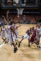 Florida State Seminoles forward Ryan Reid (42) shoots over Virginia Cavaliers guard J.R. Reynolds (2).  The Virginia Cavaliers Men's Basketball Team defeated the Florida State Seminoles 73-70 at the John Paul Jones Arena in Charlottesville, VA on February 17, 2007.
