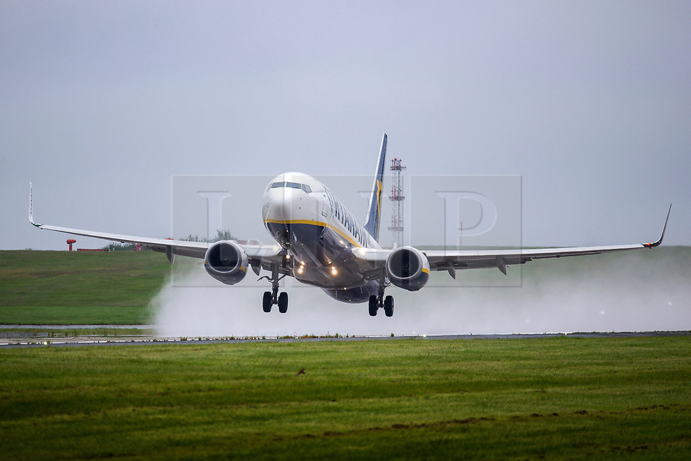 © Licensed to London News Pictures. 02/07/2020. Leeds UK. A Ryanair aircraft heading to Palma takes off in the rain from Leeds Bradford airport this morning. It is thought the Prime Minister is expected to give the green light for Britons to travel to 95 foreign destinations later today. The move could put holidays back on the agenda for some and it also signals the end of the UK's blanket quarantine policy on arrivals to the UK. Photo credit: Andrew McCaren/LNP