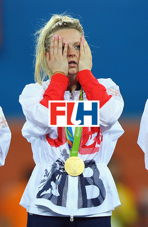 RIO DE JANEIRO, BRAZIL - AUGUST 19:  Hollie Webb #20 of Great Britain reacts on the podium after defeating Netherlands in the Women's Gold Medal Match on Day 14 of the Rio 2016 Olympic Games at the Olympic Hockey Centre on August 19, 2016 in Rio de Janeiro, Brazil.  (Photo by Tom Pennington/Getty Images)