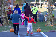 Middletown, New York  - People walk to the Halloween Fall Festival at the Middletown YMCA Center for Youth Programs on Oct. 26, 2013.