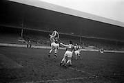 16/02/1964<br /> 02/16/1964<br /> 16 February 1964<br /> Railway Cup Football Semi Final: Munster v Ulster at Croke Park, Dublin. Munster full forward, M. Burke (14), and Ulster full back L. Murphy (3) jump for a high ball.