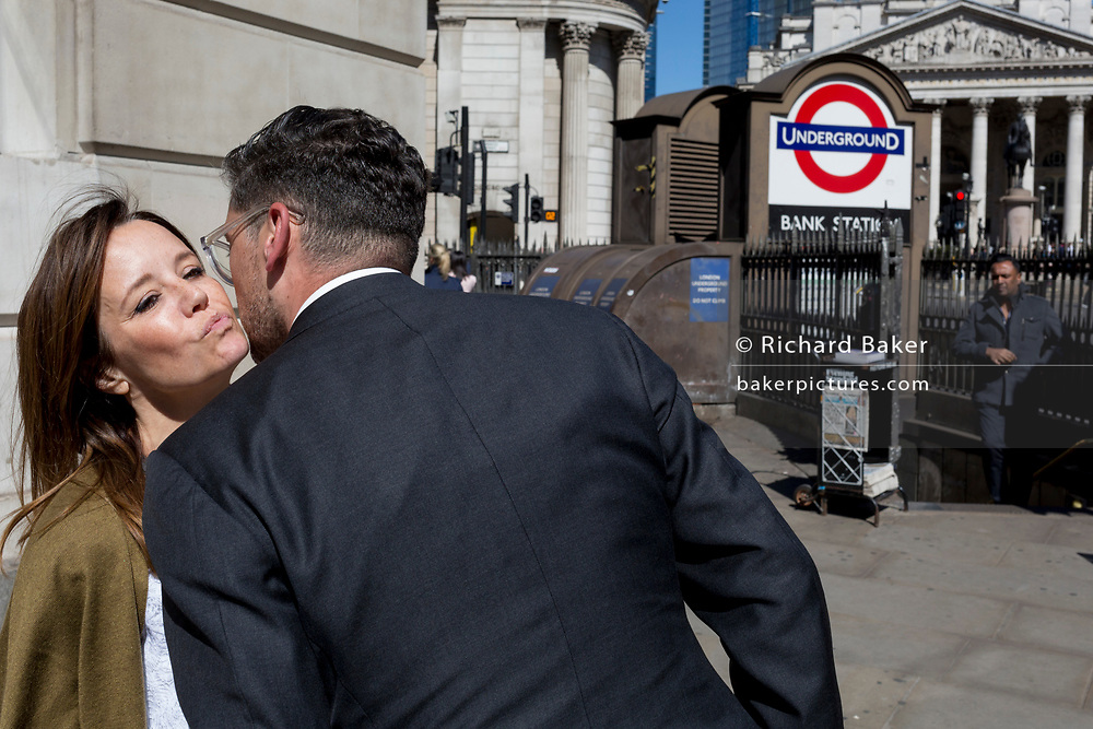 A man and woman say goodbye outside one entrance of Bank Underground Station in the City of London, the capital's ancient, financial district, on 14th May, in London, England. (Photo by Richard Baker / In Pictures via Getty Images)