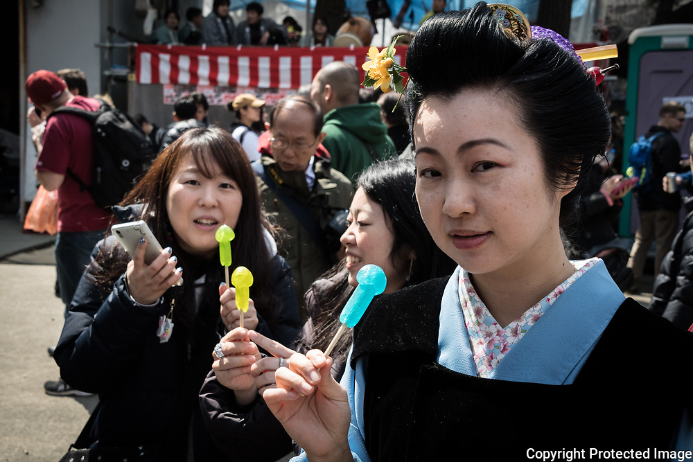 Kanamara ''Steel Phallus'' Festival in Japan Visitors eat phallus-shaped candies during the Kanamara Festival in Kawasaki on April 2, 2017, Kanagawa, Japan. The Kanamara Matsuri or Festival of the Steel Phallus is held on the first Sunday of April at the Kanayama shrine. The shrine celebrates a legend of a steel penis and was frequented by prostitutes who wished to pray for protection from sexually transmitted diseases. Visitors now wish for easy delivery, marriage and matrimonial harmony. Because of the large steel phallus the unusual festival has become a tourist attraction attracting many overseas visitors and is used to raise money for HIV charities. Phallus shaped candy, carved vegetables, decorations, and a big parade are all part of the festival.02/04/2017-Kawasaki, JAPAN