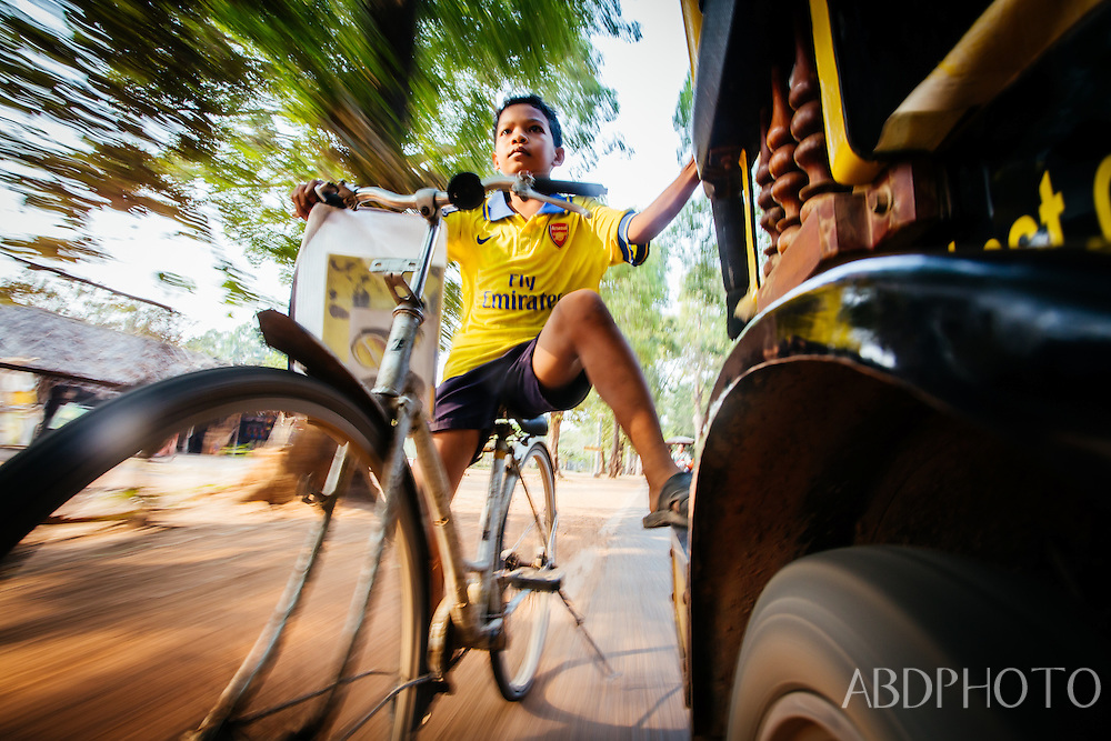boy bicycle tuk tuk siem reap cambodia