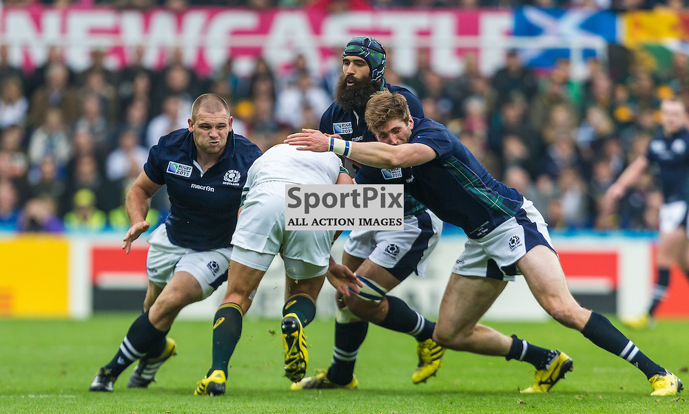 Gordon Reid, Tommy Seymour and Josh Strauss tackle Handre Pollard during the Rugby World Cup match between Scotland and South Africa (c) ROSS EAGLESHAM | Sportpix.co.uk