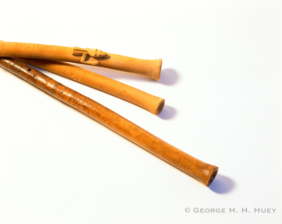 0204-1055 ~ Copyright:  George H. H. Huey ~ Flutes, including one decorated with a lizard head.  Anasazi culture.  Discovered by the Hyde Expedition in Pueblo Bonito.  Chaco Culture National Historical Park, New Mexico.