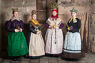 From left: Nina, Cindy, Miriam and Anja of the Trachtenverein Spalt e.V. are wearing traditional bridal costume in Spalt, Middle Frankonia, Germany on February 17, 2018.