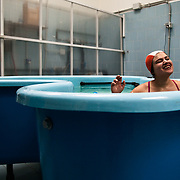 "Serena in the ""butterfly bath"" of Domus Laetitiae Institute. Playing in the hot water listening music is giving her pleasure and make her feeling calm."