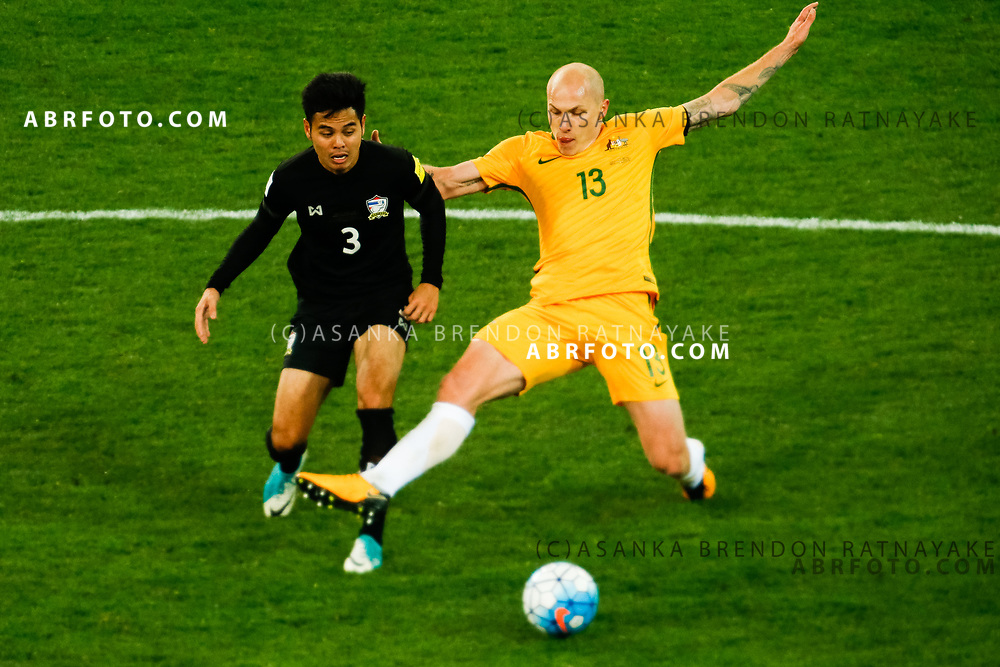 MELBOURNE, AUSTRALIA - SEPTEMBER 5 : Aaron Mooy of the Australia Socceroos tackles Theerathon Bunmatan of Thailand  during the Stage 3 Group World Cup Football Qualifiers between Australia Vs Thailand at the Melbourne Rectangular Stadium, Melbourne, Australia 5 September 2017.