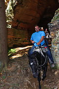 Horseback riders in Chapel Cave, aka 21 Horse Cave in the Hocking Hills region of Ohio.